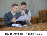 manager approving employee work ... | Shutterstock . vector #716564236