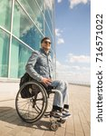 young disabled man in... | Shutterstock . vector #716571022