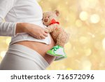pregnant woman with toy teddy... | Shutterstock . vector #716572096