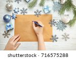 Woman Writing Letter To Santa...