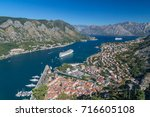 A view over the Kotor skyline during the day in the summer. A cruise liner can be seen in the water.