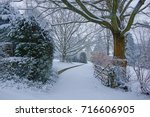 A Snowy Winter Scene With...