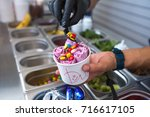 stir fried ice cream rolls at... | Shutterstock . vector #716617105