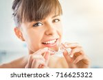 woman wearing orthodontic... | Shutterstock . vector #716625322