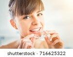 woman wearing orthodontic... | Shutterstock . vector #716625322