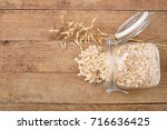 Oat Flakes In Glass Jar And...