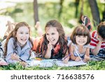 group of little girls and boy... | Shutterstock . vector #716638576