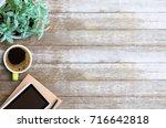 office desk table  blank paper... | Shutterstock . vector #716642818