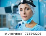 portrait of serious surgeon... | Shutterstock . vector #716643208