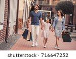 beautiful parents and their... | Shutterstock . vector #716647252