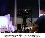 asian man with video camera... | Shutterstock . vector #716650192