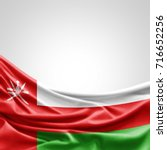 oman flag of silk with... | Shutterstock . vector #716652256