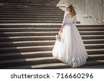 a beautiful young bride in a... | Shutterstock . vector #716660296