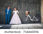 bride and groom with a bicycle... | Shutterstock . vector #716660356