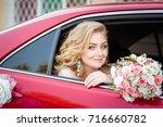 lovely young bride in wedding... | Shutterstock . vector #716660782