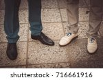 legs in the shoes of newlyweds... | Shutterstock . vector #716661916