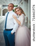 a lovely couple of newlyweds.... | Shutterstock . vector #716661976