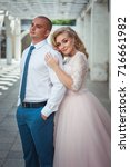 a lovely couple of newlyweds.... | Shutterstock . vector #716661982