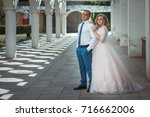 a lovely couple of newlyweds.... | Shutterstock . vector #716662006