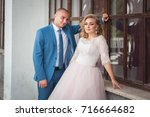 a lovely couple of newlyweds.... | Shutterstock . vector #716664682