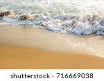 photograph of tiny wave at the... | Shutterstock . vector #716669038