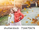 young friends in the colorful... | Shutterstock . vector #716670676