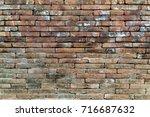 grunge brown brick wall texture....   Shutterstock . vector #716687632