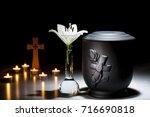 black cemetery urn with white... | Shutterstock . vector #716690818