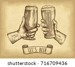 hands holding and clinking beer ...   Shutterstock .eps vector #716709436
