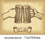 hands holding and clinking beer ...   Shutterstock .eps vector #716709466