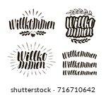 willkommen  handwritten...   Shutterstock .eps vector #716710642