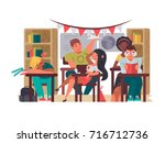 pupils sit in classroom at... | Shutterstock .eps vector #716712736