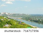 view of the city and the river... | Shutterstock . vector #716717356
