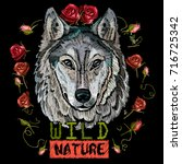 embroidery wolf  wild nature.... | Shutterstock .eps vector #716725342