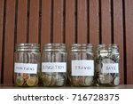 coins in glass jars  save money ... | Shutterstock . vector #716728375