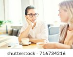 two friendly colleagues...   Shutterstock . vector #716734216