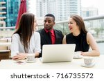 elegant smiling colleagues are... | Shutterstock . vector #716735572