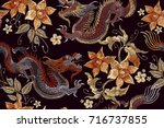 embroidery dragons and flowers... | Shutterstock .eps vector #716737855