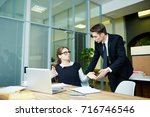 team of confident young... | Shutterstock . vector #716746546