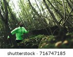 runner trains outdoors in...   Shutterstock . vector #716747185