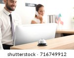 service bell and two busy... | Shutterstock . vector #716749912