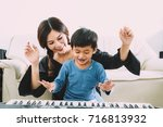 happy family playing at home... | Shutterstock . vector #716813932
