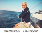 smiling mature man sitting and... | Shutterstock . vector #716822902