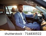 young businessman going on... | Shutterstock . vector #716830522