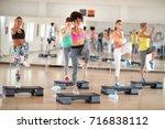 fitness group training on...   Shutterstock . vector #716838112