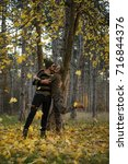couple in the autumn forest on... | Shutterstock . vector #716844376