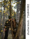 couple in the autumn forest on... | Shutterstock . vector #716844382