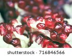 sweet ripe pomegranate close up ... | Shutterstock . vector #716846566