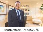 handsome african american... | Shutterstock . vector #716859076