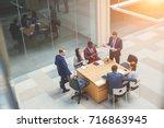 business people meeting... | Shutterstock . vector #716863945